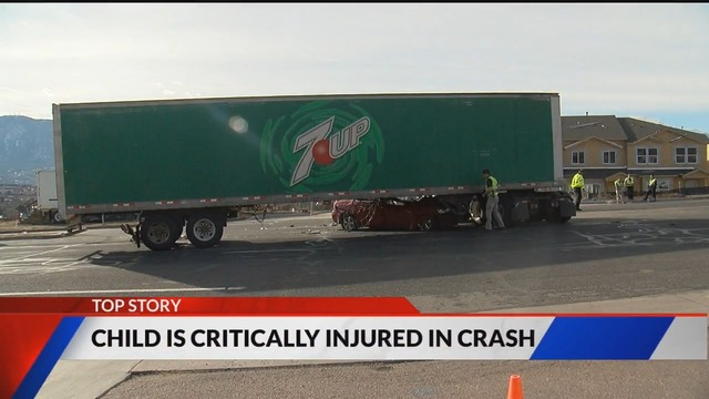 Two seriously injured in crash involving semi and sedan