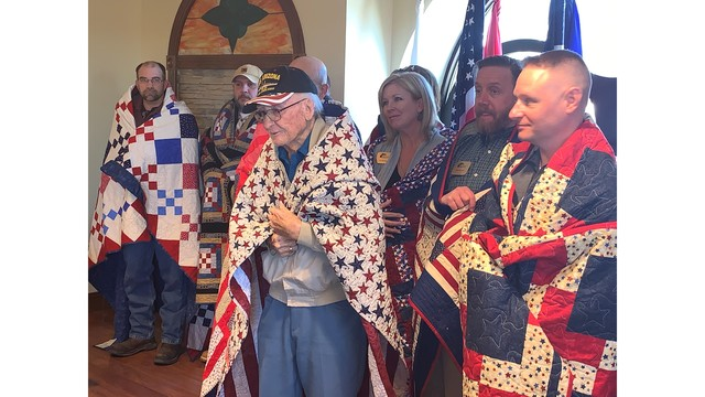 18 vets including Pearl Harbor survivor receive quilts of valor at Colorado Springs ceremony